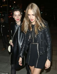 Together: Cara Delevingne and girlfriend St Vincent continue to look loved up as they were pictured leaving the Scala nightclub in London together on Wednesday night following the Wave Makers charity concert
