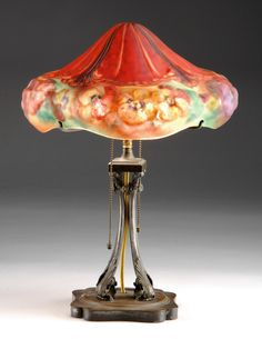 An intense, reverse painted Pairpoint puffy pansy lamp