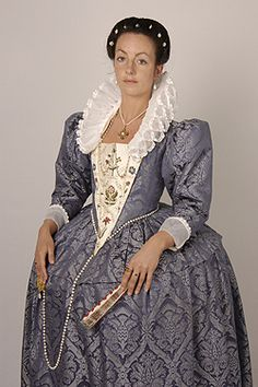 This costume was loosely based on the protrait of Elizabeth Buxton c1590 at Norwich museum and made for JMD at Hampton Court Palace as part of the events in 2003 to commemorate the death of Elizabeth I in 1603. The gown is made in blue silk damask worn over a petticoat of rose coloured silk taffeta.The stomacher and revers were embroidered using a freehand machine technique. They were then further embellished with spangles. Both both hand and machine embroidery was used in this project.