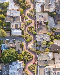 "Lombard Street | Photograph by Toby Harriman @tobyharriman | ""Lombard Street is known to be the most crooked street in the world. But Vermont Street the other San Francisco street claimed to be the ""most crooked"" has seven turns instead of eight but its hill is steeper than Lombard's."" #aerial #travel #sanfrancisco #city #yourshot #natgeo #fromabove by natgeoyourshot"