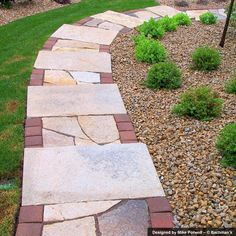 Limestone slab steps with irregular limestone treads and paver side bands.
