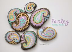 Repeat Crafter Me: Pastel Paisley Painted Rocks...explains how these are created!