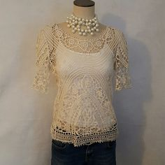 Solitaire blouse Cream colored Solitaire blouse. Match it with a camisole like in the pictures, a nice chunky necklace and you are ready to go. Blouse is lightweight and comfortable to wear. Happy shopping! solitaire Tops Blouses