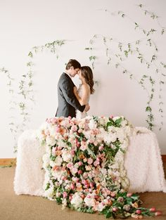 cascading floral centerpiece on sweethearts' table