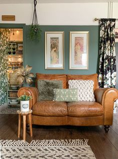 Leather loveseat in room with green walls Couch, Furniture, Home Decor, Settee, Decoration Home, Sofa, Room Decor, Home Furnishings, Sofas