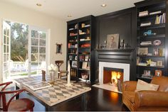 stone fireplace with dark built in bookshelves - Google Search