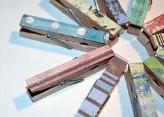 Easy DIY paper-covered clothes pins.  I already have these started...but I want to put magnets on the back for the fridge.