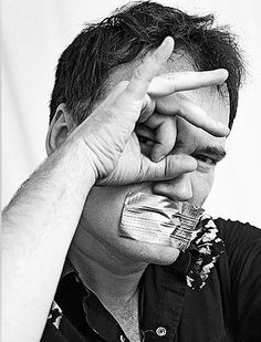 Portrait of iconic filmmaker, director and screenwriter Quentin Tarantino displaying Eye Of Horus symbolism with a piece of duct tape over his mouth representing his vow of silence. Quentin Tarantino, Sean Penn, Yoko Ono, Catherine Deneuve, Famous Men, Famous Faces, Tim Burton, New York City, All Seeing Eye