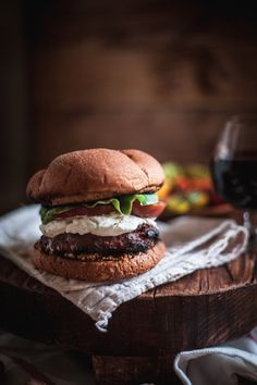 Red wine burgers with sautéed mushrooms & goat cheese with a tomato salad