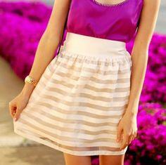 White skirt and purple shirt