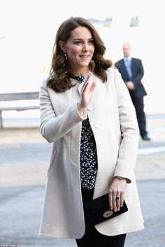Kate added a touch of colour to her ensemble with a patterned floral top from Hobbs...