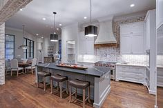 5541 Longmont Houston, TX 77056: Photo With a slight rustic charm, this kitchen displays exposed brick, cross grained marble, polished nickel fixtures, a Segreto vent hood, Wolf appliances, SubZero fridge, extra free standing oven, Wolf micro, Wolf warming drawer, & 2 Bosch Dishwashers.