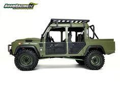 Boom Racing collaborated with Knight Customs to create a one-off Defender D110 military themed pickup truck.