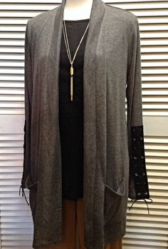 August Silk  - Grey sweater with black suede lace-up trim on sleeves  - $70
