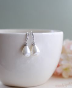 These elegant and classy bridal earrings are made of large, high quality teardrop shell pearls. Pearls are in cream white color and hang from silver