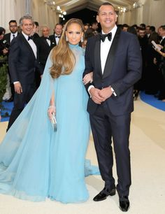 As far as red carpet debut go, they don't come much bigger than the Met Gala. Jennifer Lopez made her first public appearance with her baseball star beau Alex Rodriguez at this year's Met Gala. Alex Rodriguez, Jennifer Lopez, Jennifer Garner, Celebrity Couples, Celebrity Dresses, Celebrity Style, Red Carpet Dresses, Blue Dresses, Valentino Gowns