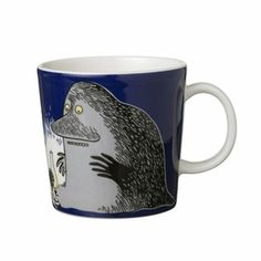 Arabia ~ The Groke character leaves an icy layer on everything she encounters. She appears twice on this mug, once standing over a small light and on the back side walking away from the viewer.  Have.