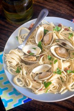 Steamed Clams with Chorizo Oil. A super simple dinner idea that's perfect for late summer nights!