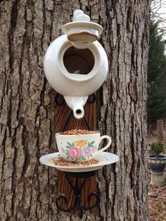 Tea Pot Bird Feeder. Isn't this cute for a favourite teapot that got a little chipped but you can't part with?
