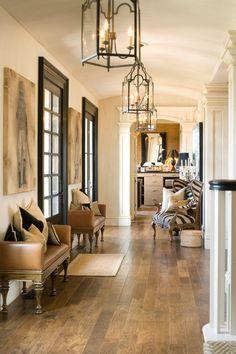 Black, white & tan foyer with elaborate molding -- Joy Tribout Interior Design
