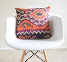 Welcome to SimplySkandi :)  Pattern: Kilim/Aztec/Tribal Design in Orange and Purple.  Item: Decorative Cushion Cover (insert not included) Product Dimensions: 18 x 18  Material: Linen Blend  Care: Hand wash in cold water with mild detergent, lay flat to dry  Print on one side only. Base fabric is an off-white color Shipment: We use Royal Mail First Class. Items will be dispatched on the same day as receiving the payment.