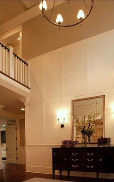 This is really my kind of entryway. I love the millwork and how private it feels you dont see the whole house when you open the front doo. Luxury Interior Design, Interior Decorating, High Ceiling Decorating, Decorating Ideas, Foyer Decorating, Tall Wall Decor, High Ceiling Living Room, Wall Molding, Moulding