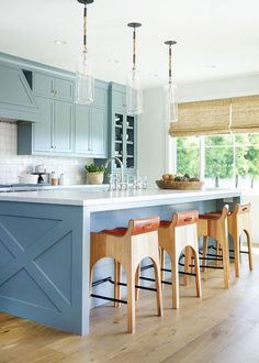 Blue coastal kitchen design with modern wood stools. This Coastal California Home Made Our Jaws Drop Coastal Bedrooms, Coastal Homes, Coastal Cottage, Coastal Kitchens, White Kitchens, Coastal Style, Coastal Decor, Modern Coastal, Home Design