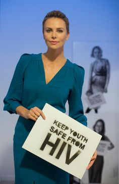Charlize Theron in our Autumn '13 teal dress at the Opening Ceremony of the World Economic Forum accepting an award for her humanitarian work.