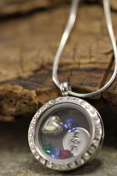 Beautiful Glass Locket with Hand Stamped charms and birthstones, perfect mothers day family necklace