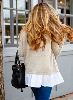 I love the flowy shirt under the cardigan.  I'm tall...so I need the layered look.
