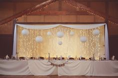 Wedding reception lighting idea - Chinese paper lanterns and hanging string lights  {Elisavet Photography}