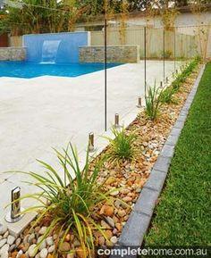 garden bedding running beside the pool fence #PoolLandscape