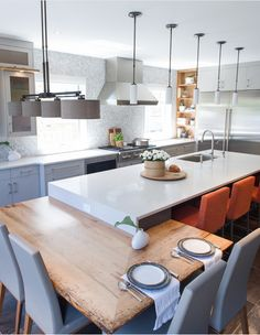 The kitchen is a bit contemporary, but the wood table addition to the island coupled with the counter hight seating is kind of cool.