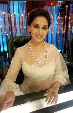 Madhuri Dixit in Tarun Tahiliani -- love the long sheer sleeves on the choli.