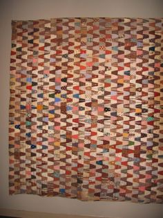 1876 centennial tumbler quilt.    Look at those striped fabrics and zigzag pattern!