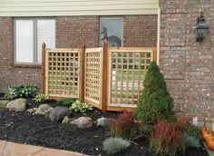 Woodbourne Landscape Architects uses this Asian influence separation wall in this outdoor space.