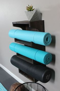 Small-Space Home Gym Hacks for Your Tiny Apartment Keep your yoga mats on display with this DIY rack.Keep your yoga mats on display with this DIY rack. Basement Gym, Garage Gym, Basement Ideas, Basement Entrance, Garage Attic, Attic House, Basement Bedrooms, Fitness Workouts, At Home Workouts