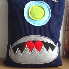 Monster cushion up cycled from a jumper