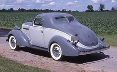 1936 Studebaker coupe, 3/4 rear view, color