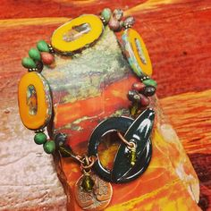Another new bracelet, with Czech glass, copper, bronze, Swarovski, and a beautiful emerald green enamel toggle clasp by C-Koop in Minnesota
