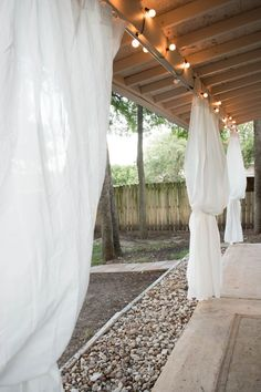 Looking for backyard ideas on a budget? Ever wanted that dreamy look of curtains in your backyard? The entire DIY upgrade was less than $20!