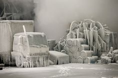 Firefighters spray down hot spots on an ice covered warehouse that caught fire Tuesday night in Chicago January 23, 2013.