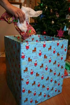 wrap a big box to throw trash in on christmas.. looks much nicer than a garbage bag in pictures!