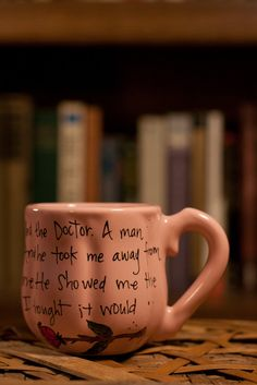 """Doctor Who """"And then I met a man called The Doctor."""" Rose Tyler quote mug - Small, bubblegum pink, pumpkin-shaped mug with sonic screwdriver. $14.00, via Etsy."""