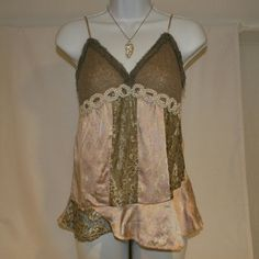 Moda International silk tanktop Beautiful Silk tanktop with lace. Pink, gray.  Pearls lined under bustline. Adjustable straps which fit either the taller or more petite lady. Very soft, feminine and flowing material. Brand:  Moda International.  In excellent condition, only worn a few times at most. Ordered from Victoria Secret catalog. Moda International Tops