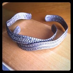 Set of 2 Silver Toned Bracelets Two wavy bracelets. Silver toned but not sterling. Good condition. Nice pieces to have in your jewelry collection! Jewelry Bracelets