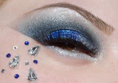 Teardrop and round crystals accent shimmering blue and white glitter eye shadow, titled ''Ocean Tears''.