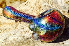 This pipe is made with hand-pulled dichroic tubing, which I carefully shaped into a rock solid pipe that will shine and shimmer with the best of