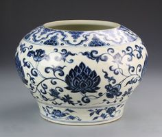 China, Ming Dynasty Blue and White jar, altered., rounded vessel body with footed base, large lotus blossom surrounded by scrolling vines and auspicious symbols, floral motif at base. Height 11 in., Diameter 7 1/2 in.