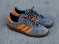efcc9eb6e017 The latest release of the Spezial sees the old school handball sneaker  dressed in grey suede with orange leather detailing on a gum sole.